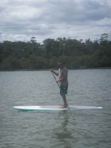 Dad paddle boarding