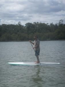 Dad paddle boarding