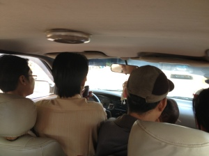 this is inside the taxi to Battambang. The guy second from left is driving. They managed to fit 4adults and a child across the front seat.....